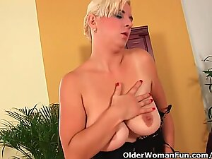Busty soccer mom probes her hairy pussy with hand and dildo