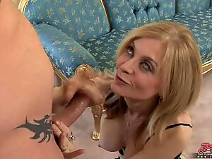 Blonde mom Nina Hartley fills her hot mouth with a young man's thick dick
