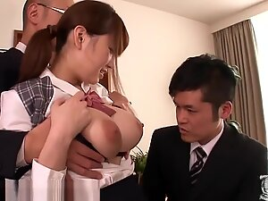 Busty oriental woman in the office with three business men.