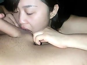 Asian girl giving blowjob and getting fucked from behind