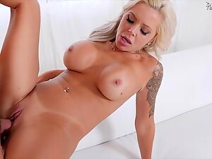 Mature blonde with big tits is drilled hard in pussy